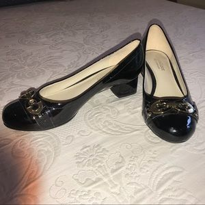 EUC Naturalizer Black Patent pump gold buckle 4.5